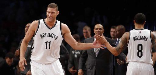 Nets' Brook Lopez celebrates with teammate Brooklyn Nets'