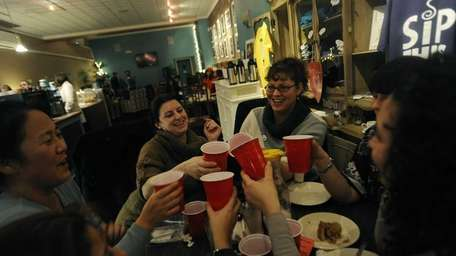 Friends toast at Sip This in Valley Stream.