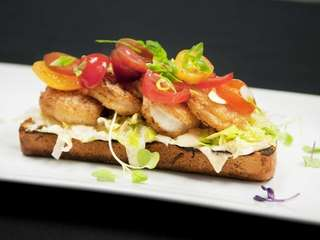 Heirloom tomatoes and sauce remoulade complete the savory