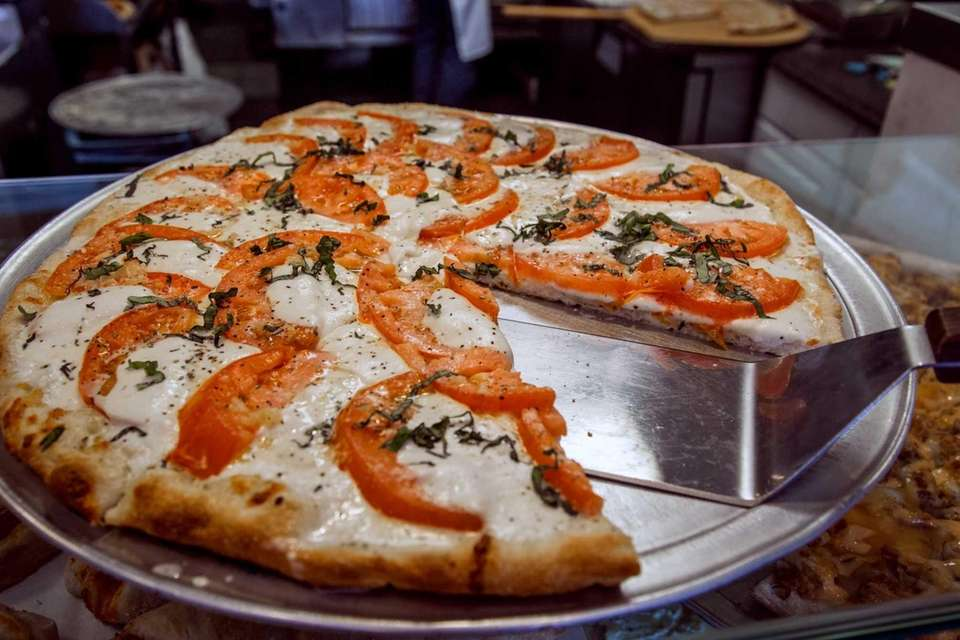 Fresh tomato and mozzarella pizza at Fargiano's Pizza