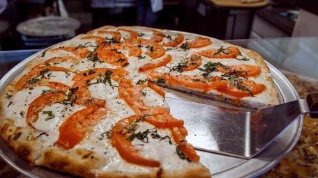 Fresh tomato and mozzarella pizza at Fargiano's Pizza