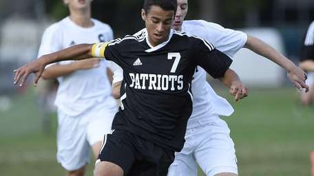 Ward Melville's Alex Garcia controls the ball against