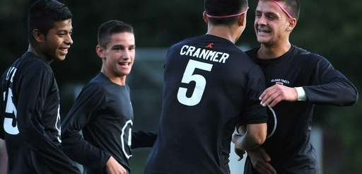 Island Trees' Dylan Cranmer gets congratulated by teammates,