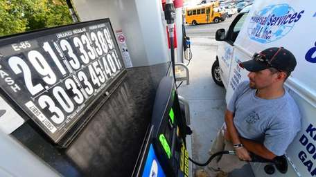 Jimmy Carl, of Baldwin, puts gas in his