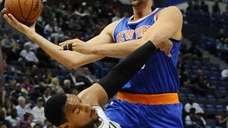 Knicks center Andrea Bargnani, right, fouls Boston Celtics