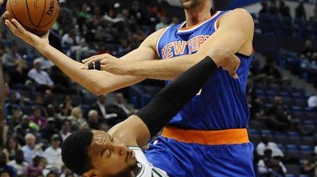 Knicks center Andrea Bargnani, right, fouls Boston Celtics