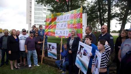 Mastic Beach residents and local officials protest outside