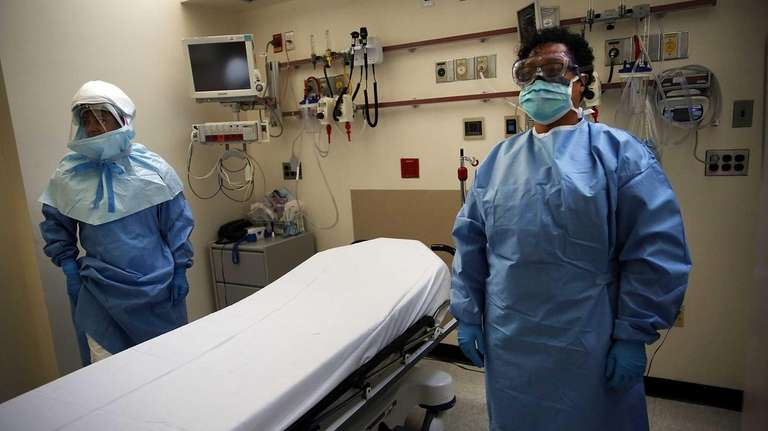 Members of Bellevue Hospital staff wear protective clothing