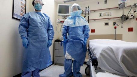 Bellevue Hospital nurse Belkys Fortune, left, and Teressa