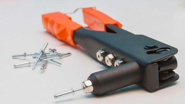 A pop rivet gun and pop rivets.