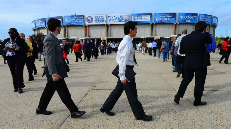 Job seekers gather Oct. 7, 2014, at Nassau