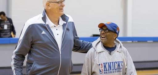 Knicks president Phil Jackson, left, walks with director
