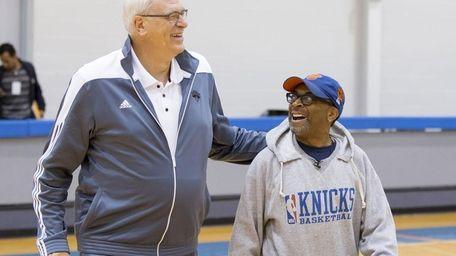 Knicks president Phil Jackson, left, walks with director