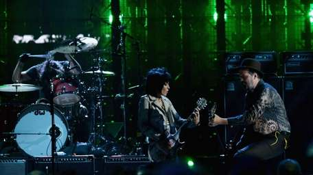 Joan Jett performs with Nirvana's Dave Grohl and