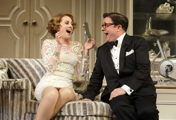 Megan Mullally and Nathan Lane in a scene