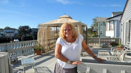 Jane Faiella stands outside her four-bedroom, four-bathroom expanded