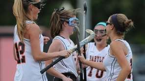 Babylon's Rori Sutkowski, far left, celebrates with teammates,