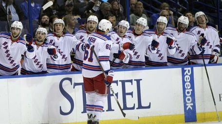 Rangers' Rick Nash celebrates with teammates on the