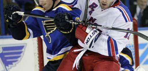 St. Louis Blues' Ian Cole collides with Rangers'