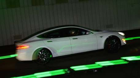 Drivers test the new Tesla 'D' model which