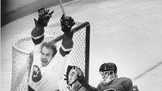 New York Islanders right winger Bobby Nystrom exults