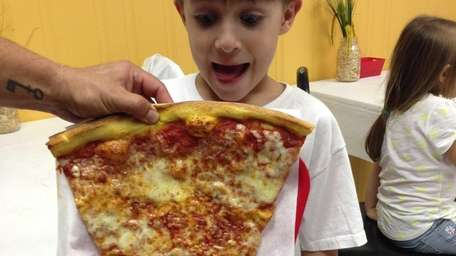 A slice of the 34-inch Penn Station pizza