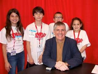 Author Rick Riordan with Kidsday reporters (l) Jaclyn