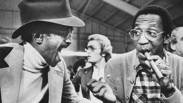 Entertainer Sammy Davis Jr. shares a laugh with