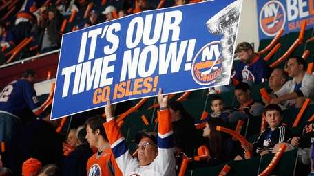 An Islanders fan holds a sign during warm