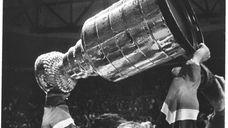 Islanders captain Denis Potvin hoists the Stanley Cup