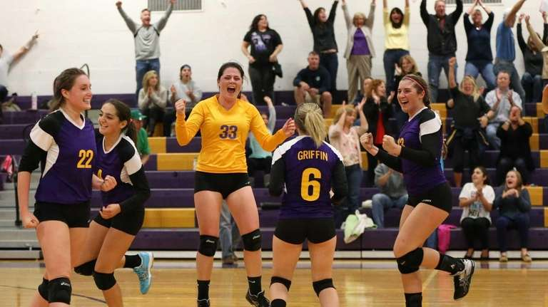 Sayville players celebrate the final point of the
