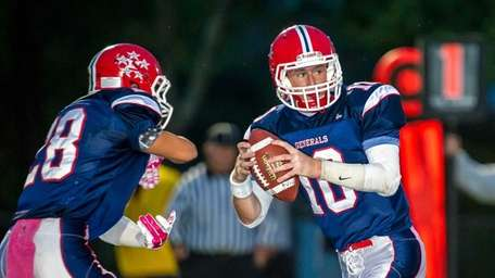 MacArthur quarterback Jimmy Kelleher steps back to pass