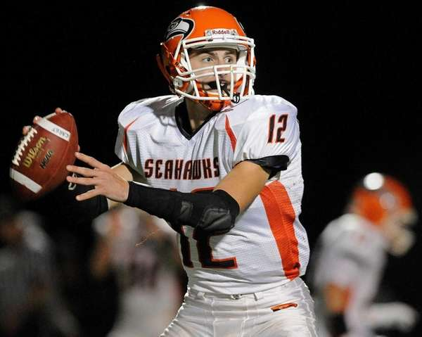 Carey quarterback Michael Catanese throws a pass for