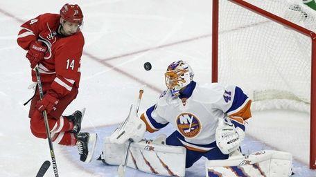 Islanders goalie Jaroslav Halak defends the goal as