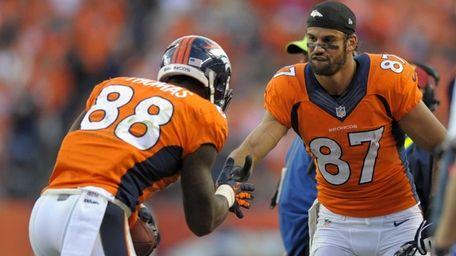 Denver Broncos wide receiver Eric Decker congratulates wide