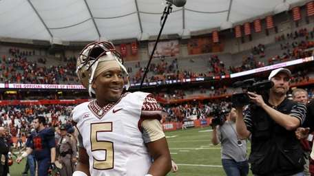 Florida State quarterback Jameis Winston smiles as he