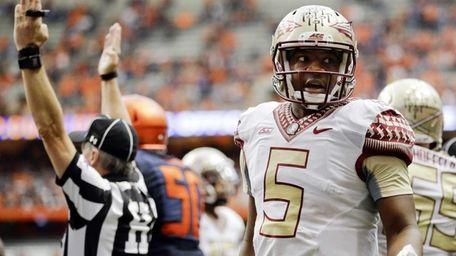 Florida State quarterback Jameis Winston talks to Syracuse's