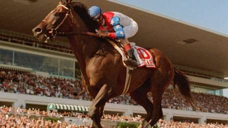 Jerry Bailey rides Cigar to victory in the