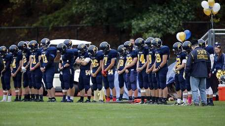 Shoreham-Wading River players line up on the sidelines