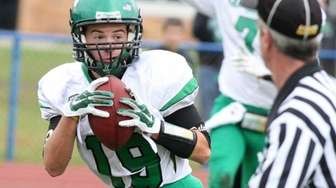 Farmingdale wide receiver Nick Butler catches a ball