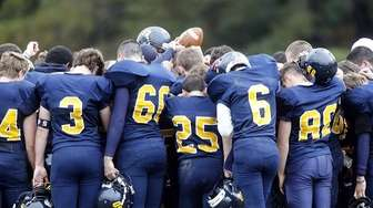 Shoreham-Wading River players huddle after the game against