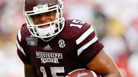 Dak Prescott of the Mississippi State Bulldogs rushes