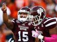 Dak Prescott of the Mississippi State Bulldogs reacts