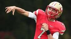 Half Hollow Hills West quarterback Anthony Lucarelli scrambles