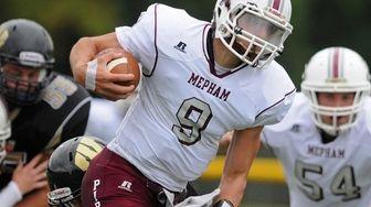 Mepham quarterback Tyler Davis rushes for a gain
