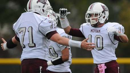 Mepham wide receiver Cormac Quigley, right, gets congratulated