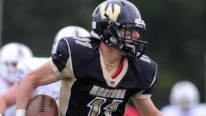 Wantagh's Dylan Beckwith rushes for a gain during