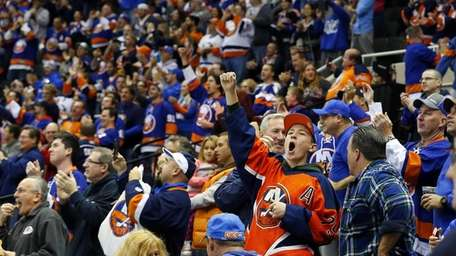 Islanders fans cheer a first-period goal against the