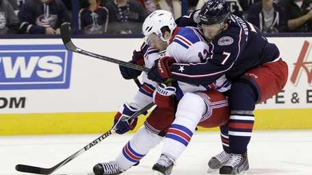 Columbus Blue Jackets' Jack Johnson, right, holds Rangers'