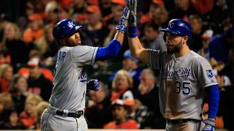 Alcides Escobar celebrates with teammate Billy Butler after